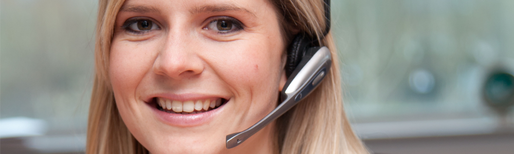 A female with a headset on in the customer services team